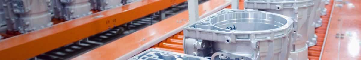 Precision cast metal parts on conveyor
